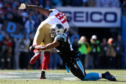 Mike Mitchell of the Carolina Panthers Anquan Boldin of the San Francisco 49ers is tackled by Mike Mitchell of the Carolina Panthers in the second quarter during the NFC Divisional Playoff Game at Bank of America Stadium on January 12, 2014 in Charlotte, North Carolina.