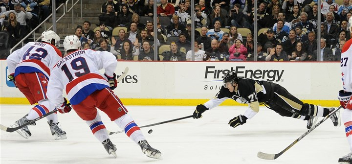 20140311rldPensVsCapitals09-3 Penguins center Evgeni Malkin, dives for the puck during the third period.