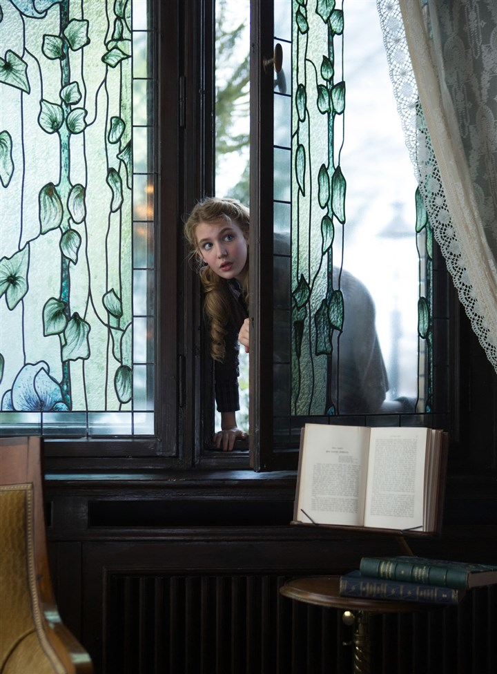 "20140313HOBookthiefDVD Sophie Nelisse as Liesel sneaks into a neighbor's well-stocked library to pursue her love of reading in ""The Book Thief."""