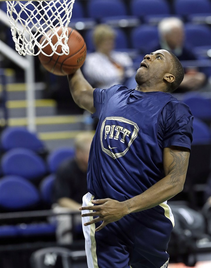 pittacc0312 Pitt's Lamar Patterson drives for a dunk in a practice Tuesday for the ACC tournament in Greensboro, N.C.