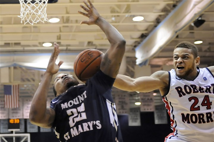20140311mfrmusports11-5 Robert Morris' Aaron Tate, right, fouls Mount St. Mary's Rashad Whack as he tries to block a shot in the Northeast Conference championship game Tuesday night at Sewall Center.