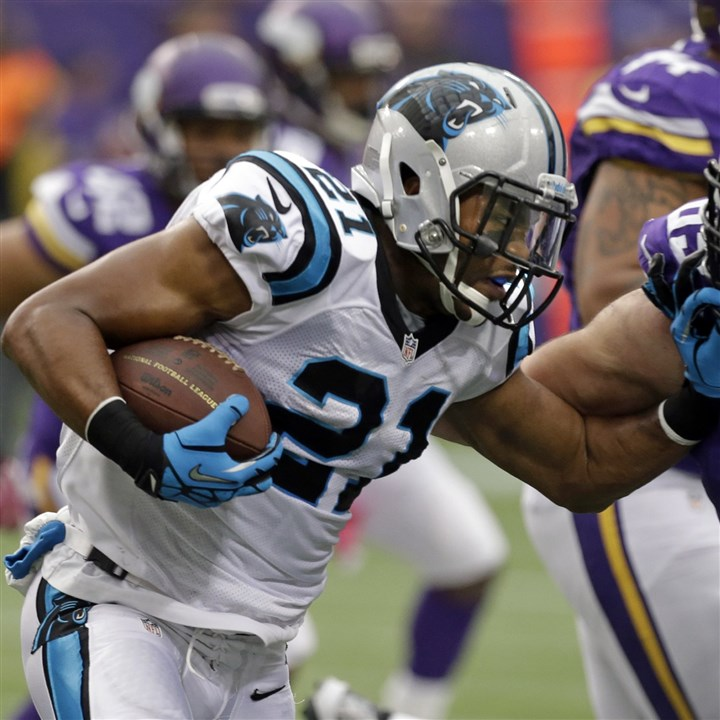 Mike Mitchell Carolina Panthers free safety Mike Mitchell, left, is tackled by Minnesota Vikings center John Sullivan after an interception during the first half of an NFL football game in Minneapolis, Sunday, Oct. 13, 2013.