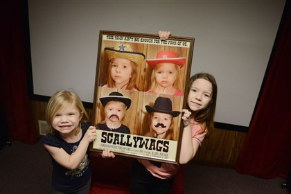 Starring-Jillian-Addie Sisters Adelaide, 6, left, and Jillian McLaughlin, 8, pose for a portrait inside their Forest Hills home studio where they film videos for their YouTube channel on Tuesday, March 11, 2014.