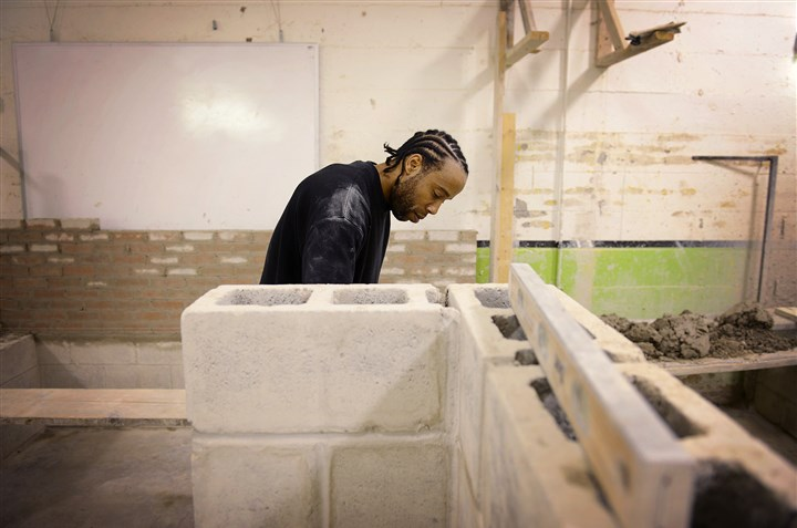 "Ryan Kelley, 35, of Wilkinsburg Ryan Kelley, 35, of Wilkinsburg, builds a ""z wall"" on Wednesday at the Trade Institute of Pittsburgh in Wilkinsburg. Mr. Kelley said he enjoys the work and is excited for the opportunity to enter the job market and earn a decent wage. He will complete the 10-week program in two weeks."
