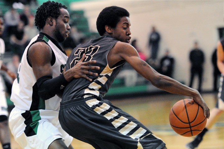 20131217JHSportsHoops05.jpg Qadir Taylor, right, being guarded by Sto-Rox's Lenny Williams during a regular-season game, and his Quaker Valley teammates have advanced to the second round of the PIAA Class AA playoffs.