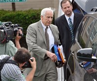Jerry Sandusky and attorney Karl Rominger, right, leave the Centre County Courthouse during Sandusky's trial in 2012.