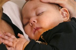 Children's health experts today issued updated safe sleeping guidelines that emphasize the importance of a baby sleeping in the same room — but not the same bed — as the mother.