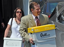 Defense attorney Karl Rominger, right, carries case files out of the Centre County Courthouse in the Jerry Sandusky trial in 2014.