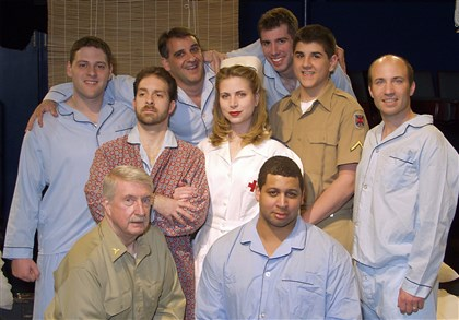 "laughlin The cast of ""The Hasty Heart,"" from left to right. Back row: Matthew C. Easton, Mark A. Calla, and Matt Marceau. Middle row: Chris Bondi, Jen Oliver, Matt D'Eramo, and Rob Gorman. Front row: Paul Laughlin and Scott Nunnally."