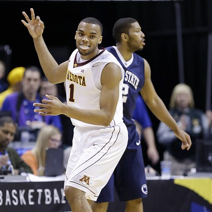 psu0314 Minnesota guard Andre Hollins celebrates after hitting a 3-pointer against Penn State late in the second half Thursday night in the Big Ten tournament.