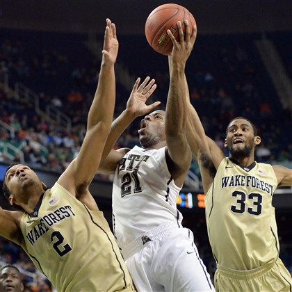 Lamar Patterson drives to the net Pitt's Lamar Patterson drives to the net against Wake Forest's Devin Thomas and Aaron Rountree III in the first half of the ACC Tournament in Greensboro Thursday afternoon.