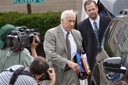 20140313attny2-1 Jerry Sandusky and attorney Karl Rominger (right) leave the Centre County Courthouse following the first day of testimony in his trial.