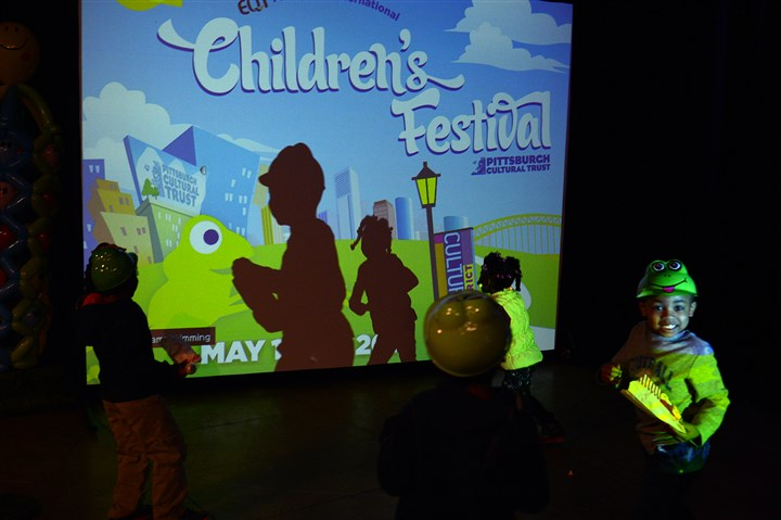 Children's festival Children from Brightside Daycare cast shadows by playing in front of a projector after a press conference for the Children's Festival Thursday at the Trust Arts Education Center Downtown. The Pittsburgh International Children's Festival moves to the Cultural District this year and will run May 14-18.
