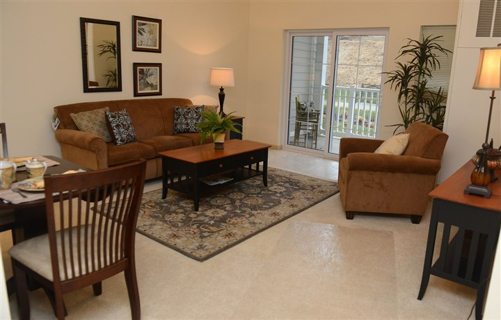 Living room Overbrook Pointe The living room in one of the two-bedroom apartments at Overbrook Pointe, an independent living community for people 55 and older.