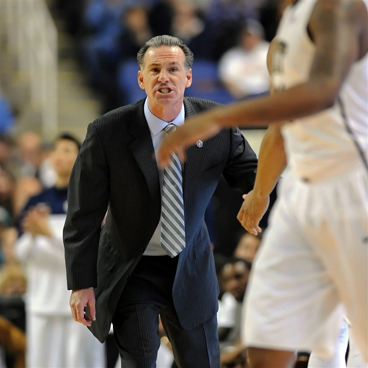 Pitt head coach Jamie Dixon Pitt head coach Jamie Dixon calls a play out to his team against Wake Forest in the first half of the ACC Tournament in Greensboro Thursday afternoon.
