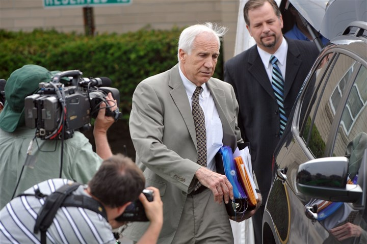 20140313attny2-1 Jerry Sandusky leaves the Centre County Courthouse following the first day of testimony in his trial in 2012.