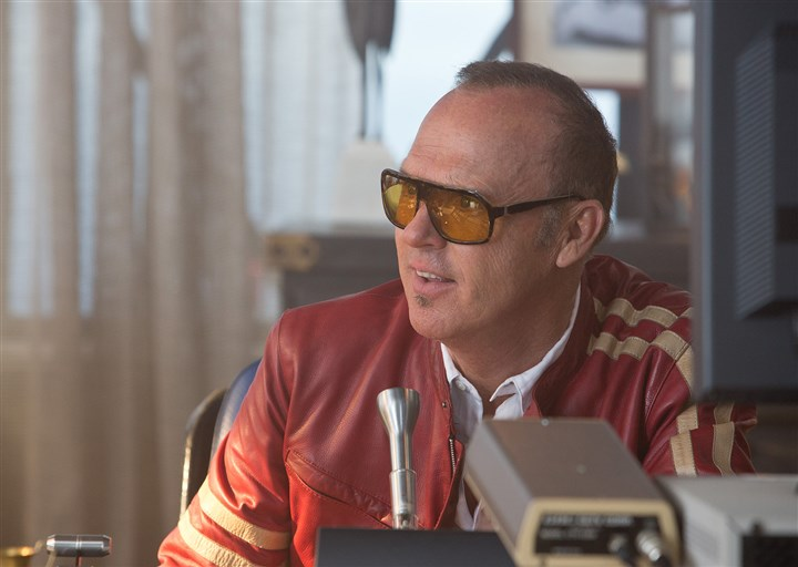 "20140314NeedforSpeed7-1 Michael Keaton stars as the Monarch, the organizer of a high-stakes underground car race known as the De Leon in ""Need for Speed."""