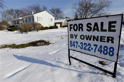 Mortgage Rates In this Friday, Dec. 27, 2013, file photo, a home is for sale in Glenview, Ill. Freddie Mac reports on changes in average fixed mortgage rates for the first week of March 2014 on Thursday, March 13, 2014. (AP Photo/Nam Y. Huh, File)