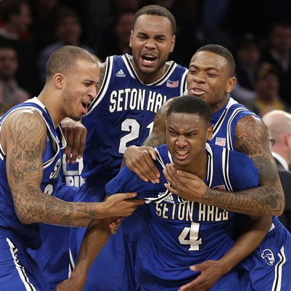 gibbs0314 Teammates mob Seton Hall's Sterling Gibbs (4) after he made the winning shot Thursday against Villanova in the second round of the Big East tournament at Madison Square Garden in New York. Seton Hall beat Villanova, the top seed and No. 3 team in the country, 64-63.