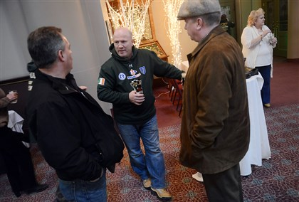 Michael Carruth coach of Team Ireland Michael Carruth, center, coach of Team Ireland and a 1992 boxing gold medalist, speaks with Joe McGee, left, and Marty O'Toole, right, before the start of a pub crawl last month to promote a boxing tournament between Irish and Pittsburgh fighters. The tournament will take place on St. Patrick's Day in the Grand Hall at the Priory on the North Side.
