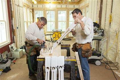"20140314oldhouse2-1 Tom Silva, left, and Norm Abram of ""This Old House"" work on building a balustrade for an 1872 Italianate in Arlington, Mass."