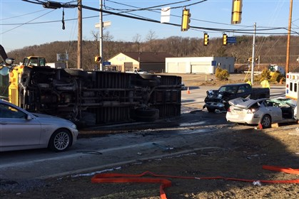 school bus drove up on top of a car A school bus drove up on top of a car when the bus driver cut the corner at the intersection of East Hardies Road and Route 8 in Hampton on Friday morning. The bus was rolled onto its side by emergency responders to get the trapped driver out of the car at right.