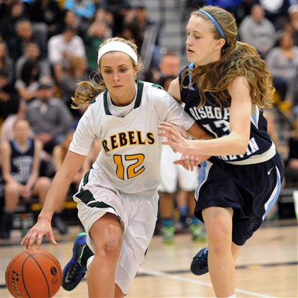 20140314JHSportsHoops01 Seton-LaSalle's Cassidy Walsh, left, drives against Bishop Canevin's Sarah Green in the second half Friday night at North Allegheny.