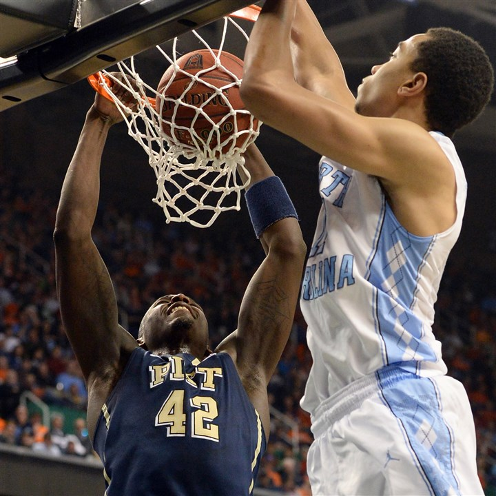 zanna0315a Pitt's Talib Zanna dunks against North Carolina's Brice Johnson in the first half of the quarterfinals of the ACC tournament Friday in Greensboro, N.C.