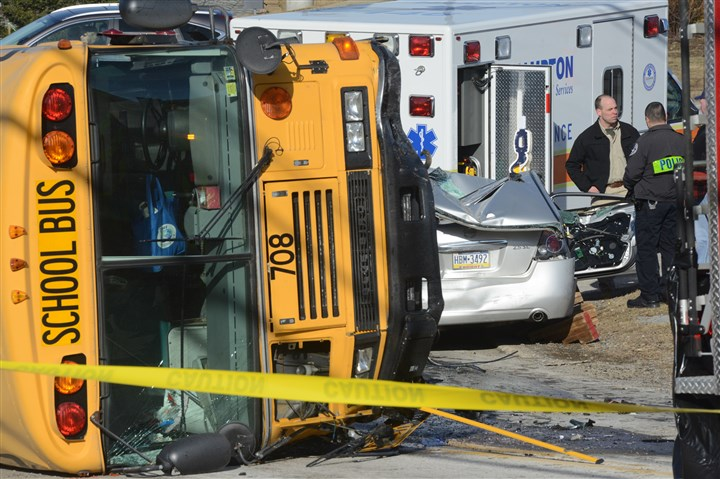 school bus was tipped on its side A school bus was tipped on its side to free the driver of a car stuck underneath at a crash scene on East Hardies Road at the intersection with Route 8 in Hampton Township.