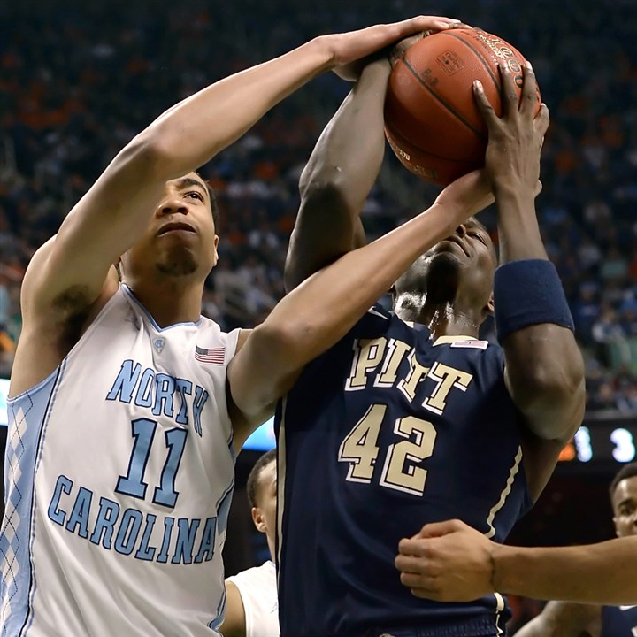 Pitt's Talib Zanna tries for rebound vs. UNC Pitt's Talib Zanna fights for a rebound against North Carolina's Brice Johnson in the first half of the quarterfinals of the ACC Tournament in Greensboro, N.C., Friday afternoon.