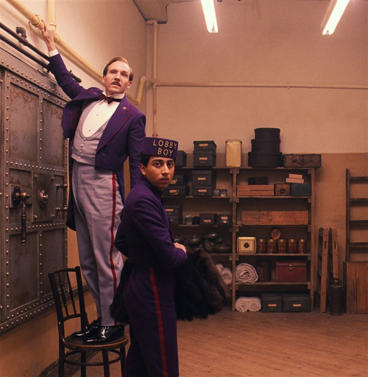 "20140321GrandBudapestHotel2-1 Ralph Fiennes and Tony Revolori in ""The Grand Budapest Hotel."""