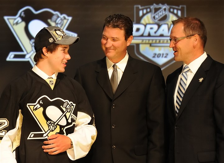 Derrick Pouliot with Mario Lemieux and Dan Bylsma Derrick Pouliot, left, with Mario Lemieux, center, and Dan Bylsma on Draft Day 2012. It's hard to imagine the return that would be required to tempt Ray Shero to trade Pouliot.