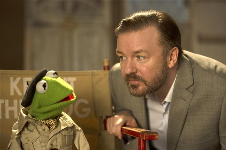 "20140321MuppetsMostWanted1-1 Kermit with Ricky Gervais in ""Muppets Most Wanted."""