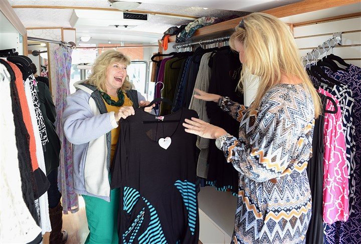 StyleTruck2013 Jackee Ging (right) helps customer Pam Palmer choose a dress inside Ms. Ging's Style Truck mobile boutique.