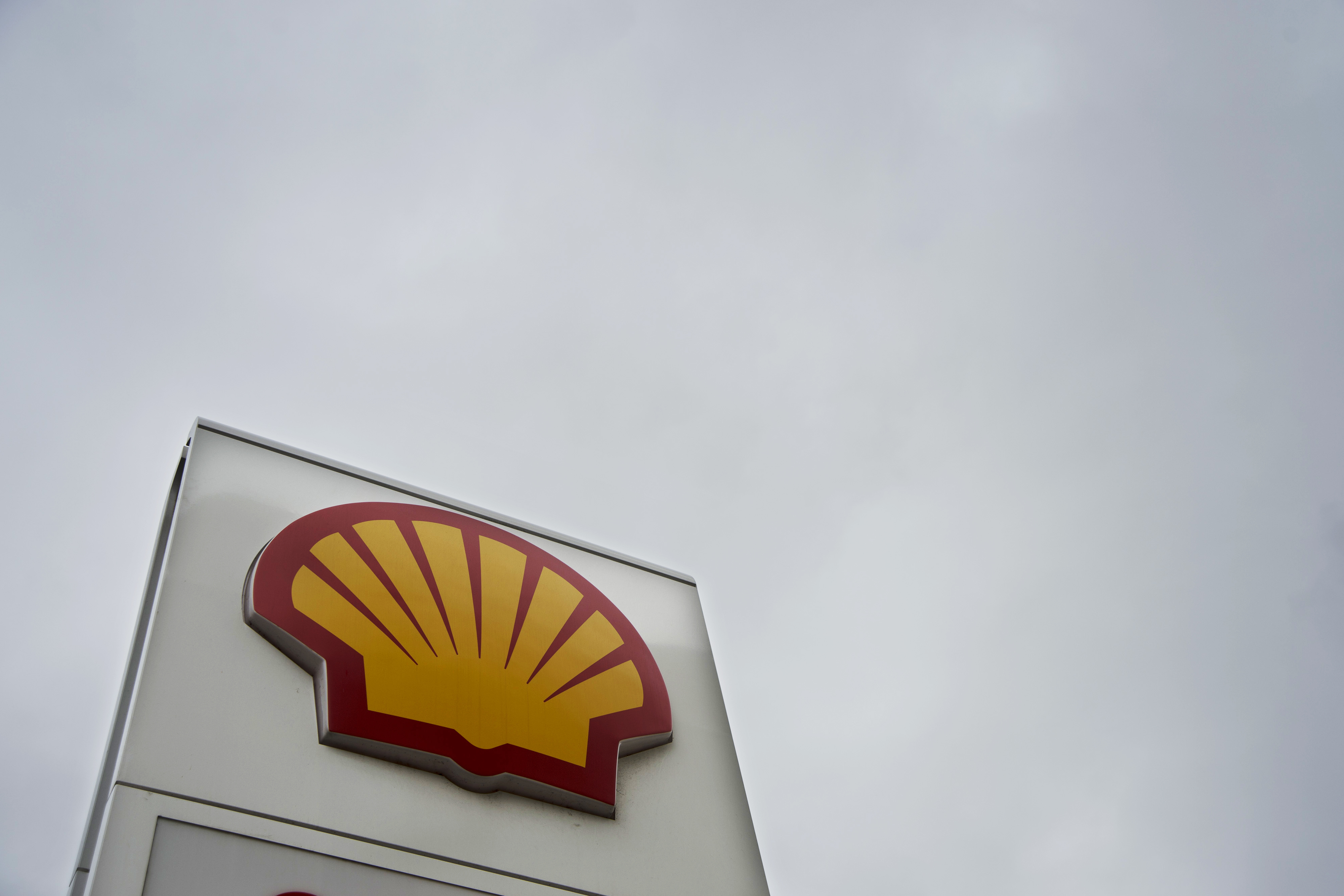 SHELLlogo The Royal Dutch Shell logo is displayed on signage at a gas station.