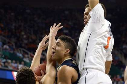Pitt's James Robinson vs. Virginia Pitt's James Robinson tries to find room between Virginia's Anthony Gill and Justin Anderson as he drives to the net in the first half of the semifinals of the ACC Tournament in Greensboro, N.C., Saturday afternoon.