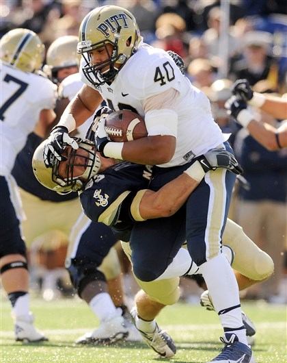 James Conner  James Conner runs over a Navy defender.