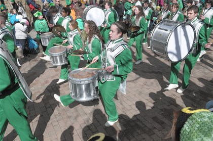 20140315ttParadeLocal (15)-6 The Little Green Machine Marching Band, from South Fayette High School, takes part in the St. Patrick's Day Parade in Downtown Pittsburgh.