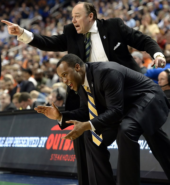 Pitt assistant coaches Pitt assistant coaches Barry Rohrssen (top) and Brandin Knight call out to their team as they take on Virginia in the second half of the semifinals of the ACC Tournament in Greensboro last monrth.
