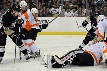 Jayson Megna Flyers goaltender Steve Mason makes a save on Penguins' Jayson Megna on Sunday.