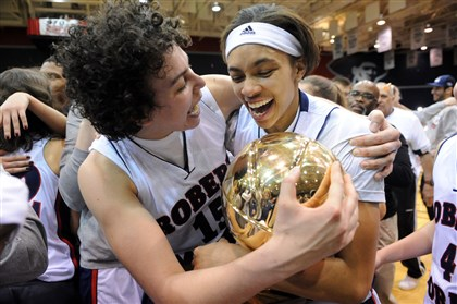 Robert Morris basketball players Robert Morris basketball players Artemis Spanou and Kelly Hartwell, both seniors, hug the NEC Championship trophy after beating Saint Francis in the championship game at the Sewell Center at Robert Morris University earlier this week.