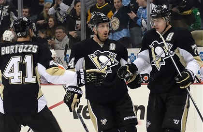 Brooks Orpik, Robert Bortuzzo and Evgeni Malkin Penguins' Brooks Orpik is congratulated by Robert Bortuzzo and Evgeni Malkin after scoring against the Flyers in the first period.