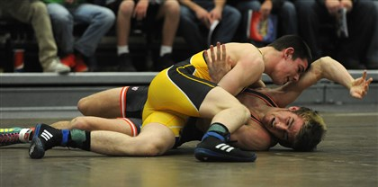 hsprelim2 Franklin Regional's Tyler Smith tries to pin Bixby's Justin Fletcher in the 132-pound weight class Sunday in the WPIAL vs. Oklahoma portion of the 40th Annual Dapper Dan Wrestling Classic at the Fitzgerald Field House.