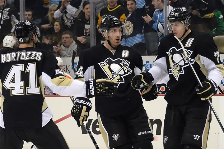 Brooks Orpik, Robert Bortuzzo and Evgeni Malkin The Penguins' Brooks Orpik, Robert Bortuzzo and Evgeni Malkin.