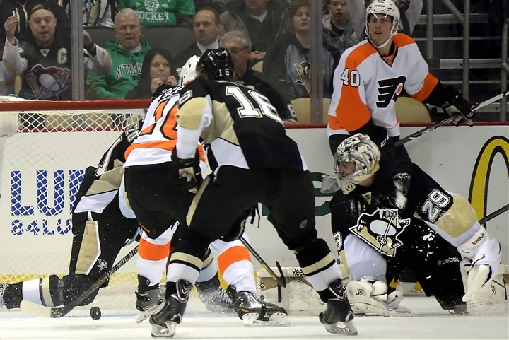 Penguins goaltender Marc-Andre Fleury Penguins goaltender Marc-Andre Fleury watches a shot by Flyers' Brayden Schenn go in the net for a goal in the first period.