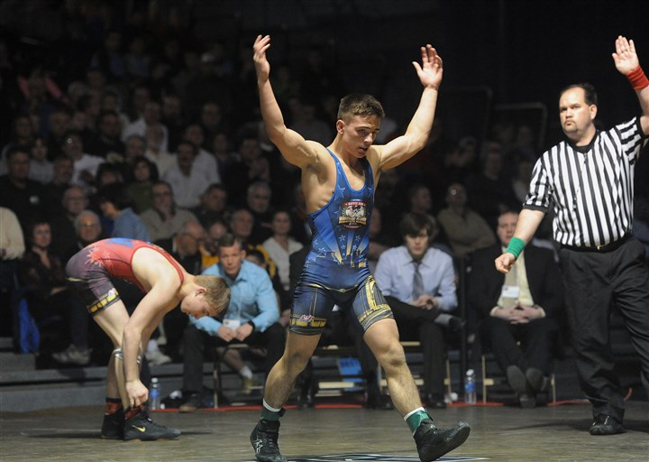 hsfeature2 Dalton Macri of Canon-McMillan celebrates as he takes the lead in 120 lb. class against Nathan Boston of Woodford Co., Ky. during the Pennsylvania vs. USA match at the 40th Annual Dapper Dan Wrestling Classic at the Fitzgerald Field House.