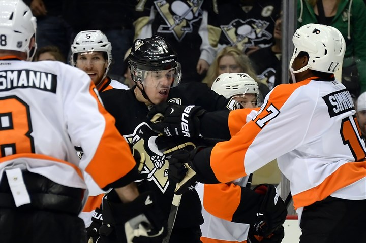 Geno takes in on the chin Evgeni Malkin takes a hit on the chin from the Flyers' Wayne Simmonds after the end of the game at Consol Energy Center Sunday afternoon.