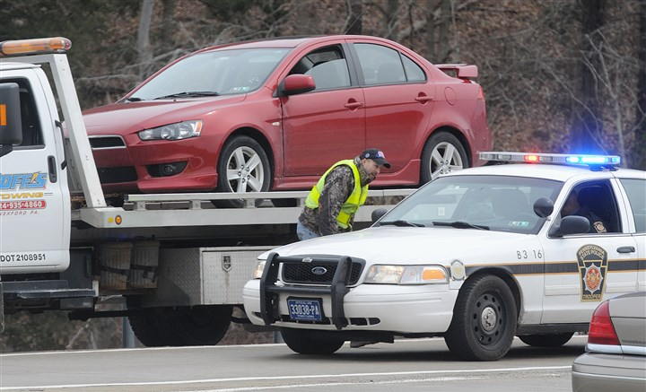 John Yuhas car State police remove the car of John Yuhas from the north-bound exit ramp to Camp Horne Road on Sunday. He bled to death from the site of surgery on his right forearm.