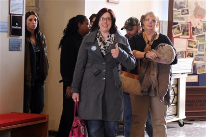 Joy Burkholder gives the thumbs up Joy Burkholder gives the thumbs up as she and her family leave the courtroom after Robert Masters and Peggy Miller were sentenced in the torture and murder of her sister Jennifer Daugherty in 2010. Ms. Burkholder is followed by their mother Denise Murphy, on right.