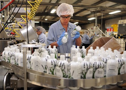 Georgina Tedrow Georgina Tedrow, loads empty bottles of Nourish Organic onto the line to be filled last year at the Sensible Organics plant in Beaver Falls.